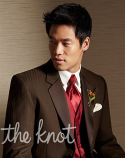 Two-button tuxedo features notch lapels, subtle tone-on-tone stripe pattern, and super 100's wool fabric.