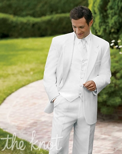 Two-button non-vented white tuxedo features flap pockets and poly/wool blend. Jacket can be paired with black or white pants.