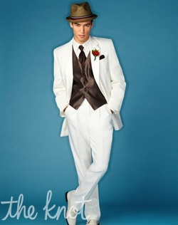 Two-button non-vented ivory tuxedo features flap pockets and poly/wool blend. Jacket can be paired with black or ivory pants.