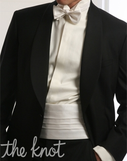 One-button tuxedo features black super 135s Australian Merino wool, grosgrain shawl lapel, and matching grosgrain beason pockets.