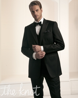 One-button tuxedo features black super 110s Italian wool, barathea cloth, and satin peak lapel.
