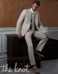 Classic two-button suit features light butterscotch super 110s pure Italian wool and notched lapel.