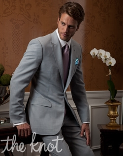 One-button suit features slate blue wool, silk, linen, and peak lapel.