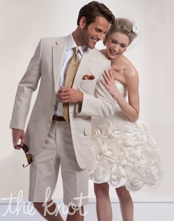 Two-button suit features sand corded cotton, notched lapel, and shorts.