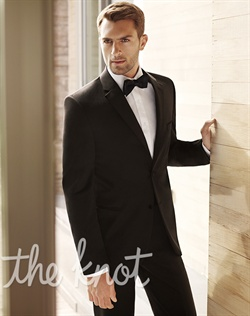Black tuxedo features contemporary styling and modern fit via slightly shorter 30-1/2&quot; coat length and narrow 2-1/2&quot; label. Two-button jacket features grosgrain notch lapel, side vents and flat-front panel with grosgrain stripe detail. Available in modern and regular fit. Designed by Vera Wang and found exclusively at Men&#39;s Wearhouse.