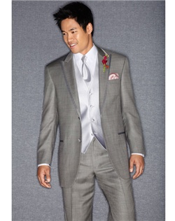 Modern gray tuxedo features two buttons, satin-edged peak lapel and flat front pants.