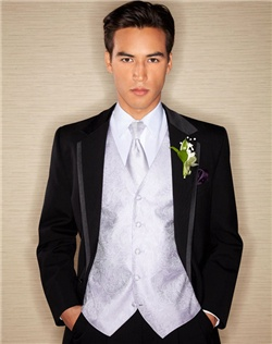Two-button non-vented tuxedo features modern styling, 100% wool fabric and black satin-lined notch lapel.
