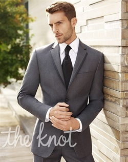 "Gray tuxedo features contemporary styling and modern fit via slightly shorter 30-1/2"" coat length and narrow 2-1/2"" label. Two-button jacket features satin-edge notch lapel, side vents and flat-front panel. Available in modern and regular fit. Designed by Vera Wang and found exclusively at Men's Wearhouse."